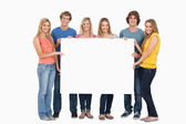 A group of holding blank sheet — Stock Photo
