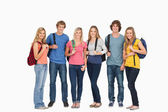 Smiling group with backpacks on as they smile — Stok fotoğraf