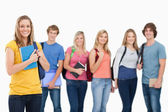 A group of college students standing as one girl stands in front — Stock Photo