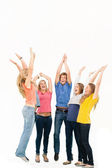 Group of friends cheering as they jump in the air and look at on — Stock Photo