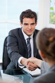 Businessman shaking hands with a Businesswoman — Stock Photo