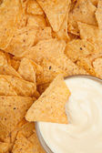 Bowl of dip surrounded by nachos — Stock Photo