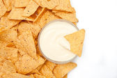 Bowl of dip surrounded by chips — Stock Photo