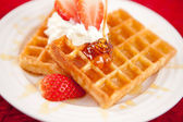 Waffles with whipped cream and strawberries — Stock Photo