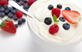Berries in a bowl with cream — Stock Photo