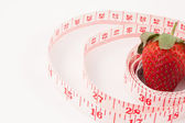 Close up of a strawberry surrounded by a ruler — Stock Photo