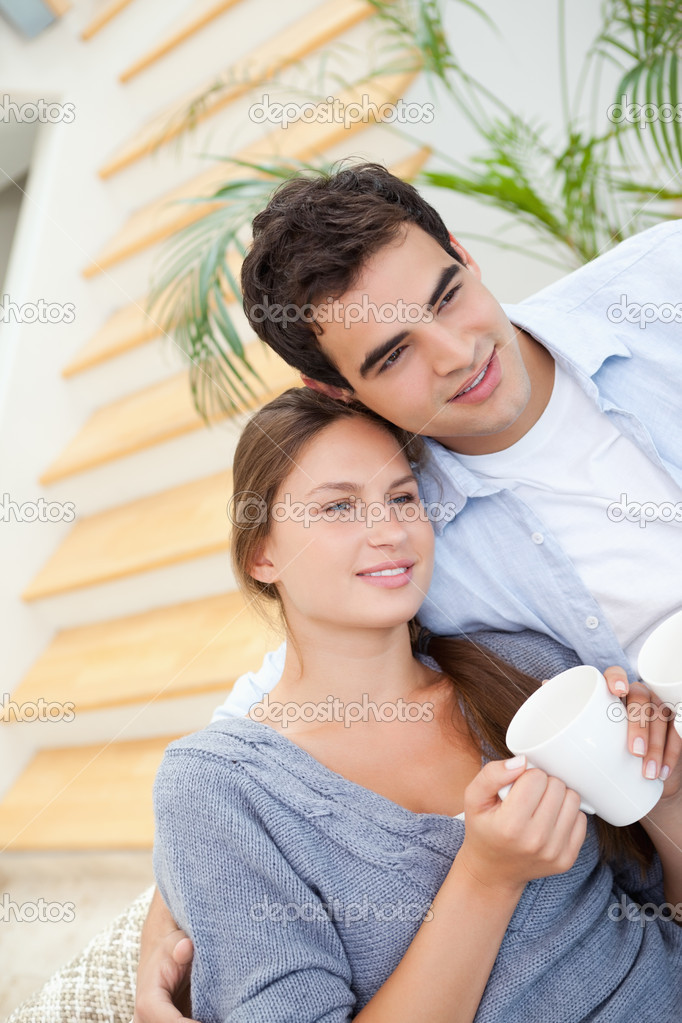 Young Couple smiling while embracing each other indoors — Stock Photo #13963368