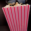 3D glasses on a box of pop corn — Stock Photo