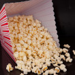 Pop corn falling out of box — Foto de Stock