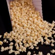 Many pop corn falling out of a box — Stock Photo #13973366