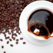 Cup of coffee with beans — Stock Photo #13973823