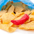 Open bag of crisps with red pimento — Stock Photo #13973957