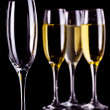 Three full glasses of champagne and one empty — Stock Photo