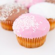 Close up on a pyramid of muffins with icing sugar — Stock Photo