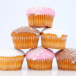 Pyramid of muffins with icing sugar — Stock Photo