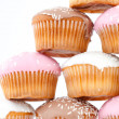 Close up on eight muffins with icing sugar placed in pyramid — Stock Photo