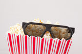 3D glasses and a box of popcorn — Stock Photo