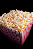 Close up of a box full of pop corn — Stock Photo