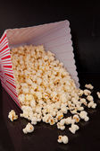 Pop corn falling out of box — Stock Photo