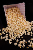 Many pop corn falling out of a box — Stock Photo