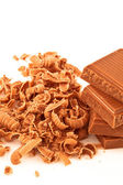 Many chocolate shavings beside a pile of chocolate — Stock Photo
