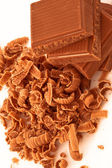 Close up of pile of chocolate pieces and chocolate shavings — Stock Photo