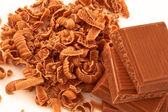 Chocolate shavings surrounding a pile of chocolate — Stock Photo