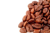 Many dark blurred coffee seeds laid out together — Stock Photo