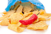 Open bag of crisps with a red pimento — Stock Photo