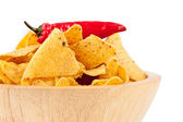 Pepper upon a bowl full of crisps — Stock Photo