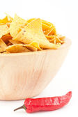 Pimento next to a bowl of crisps — Stock Photo