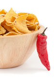 Pimento posed against a bowl full of crisps — Stock Photo