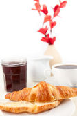 Breakfast with a bisected croissant — Stock Photo