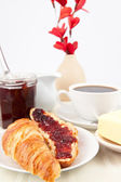 Table presentation with croissant spread with jam — Stock Photo