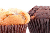 Close up of a regular muffin and a chocolate muffin — Stock Photo