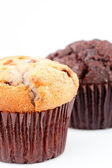 Close up of a fresh baked muffin and a blurred chocolate muffin — Stock Photo