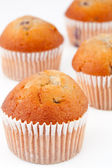 Four small baked muffins — Stock Photo