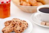 Cookies and a cup of coffee on white plates with sugar croissant — Stock Photo