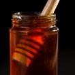 Honey dipper in a honey jar — Stock Photo #13989954