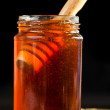 Stock Photo: Honey full jar with a honey dipper