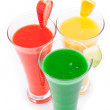 Three glasses full of fruit juice with fruits pieces — Stock Photo