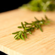 Thyme on a wooden table - Stock Photo