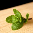Mint on a chopping board — Stock Photo