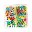 Stock Photo: Box of multicolored of pushpins paperclips and elastics