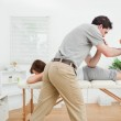 Brunette woman being stretched by a physiotherapist — Stock Photo #13992638