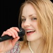 Fair-haired woman singing — Stock Photo #13996063