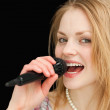 Young blond-haired woman singing — Stock Photo #13996069