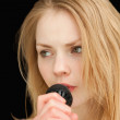 Blond-haired woman singing — Stock Photo #13996073