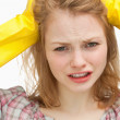 Close up of a woman pulling her hair - Stock Photo