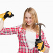 Stock Photo: Joyful womholding hammer